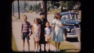 old-film-home-movie-family-street-car-1950s_ekduzgsx__S0000